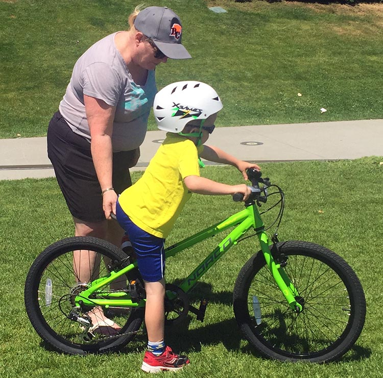 9 Simple Steps to Teach a Child to Ride a Bike. Teach your child how to get on their bike. They can practice as you hold the bike steady. How to teach a child to ride a bike