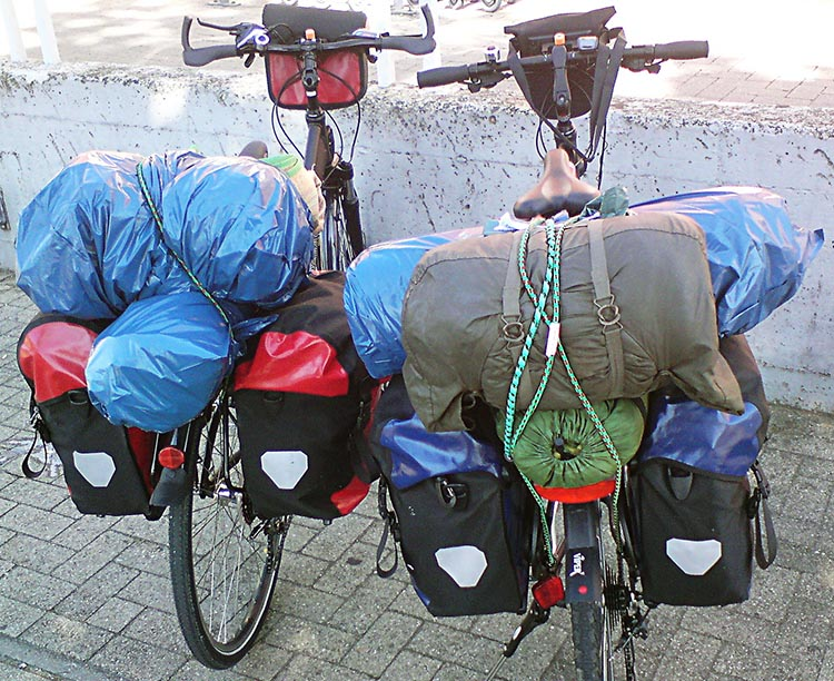 To carry your clothes and other supplies, panniers are very effective and comfortable