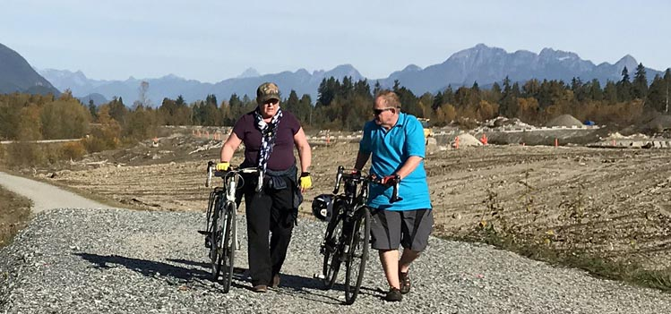 I am not exactly your stereotypical cyclist with the body of a greyhound. However, I don't let my weight stop me from cycling. This was a 15-mile cross-country ride I did with my wife. We are pushing our bikes here because we were on loose gravel