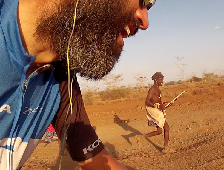 Tribesman in Kenya running with Reza