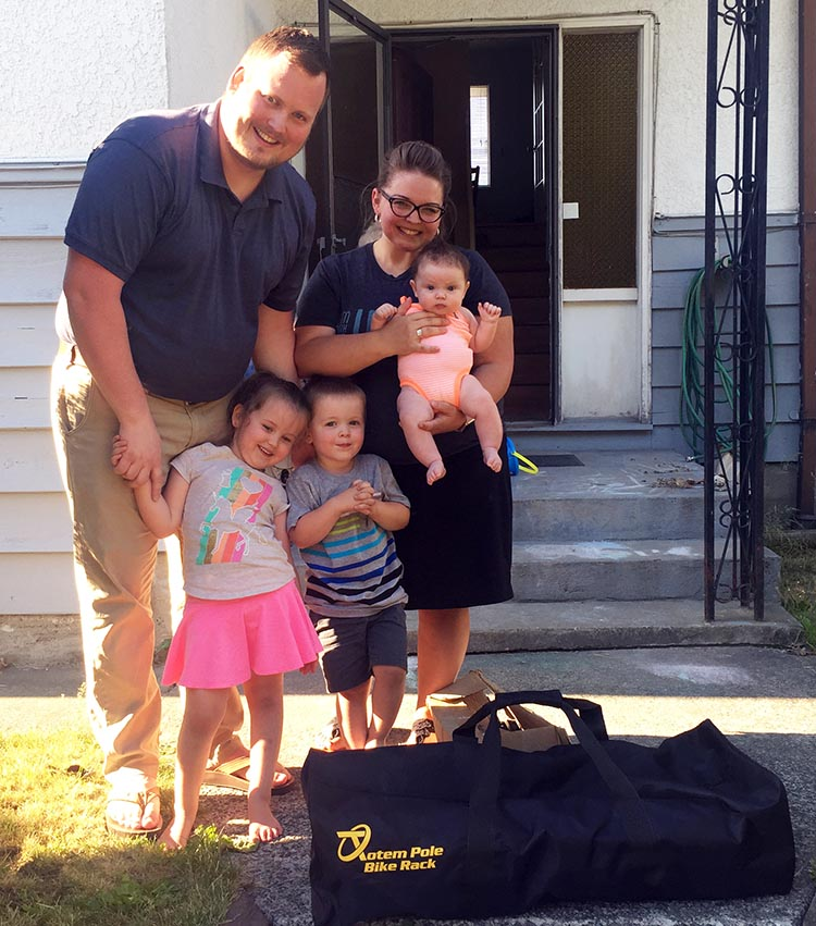 John Marc, the winner of the Totem Pole Bike Rack, with his wife Alyssa and their three children