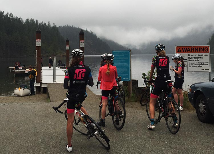 A group of impressive cyclists who had just cycled all the way up Sunnyside Road to Buntzen Lake. They stopped to enjoy the view and have a small snack, and then set off to do close-to-impossible things on their bikes again