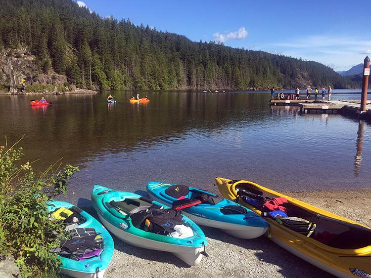 Cycling near Buntzen Lake, British Columbia, Canada. Buntzen Lake is a beautiful glacier-fed lake. At the far left side, there is a place for launching kayaks and canoes. But no motorized water vessels, so it remains quiet and pristine!