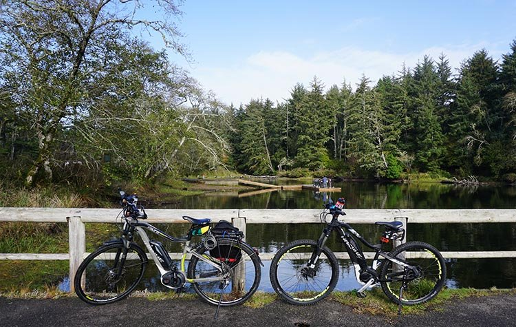 Our bikes parked at the beautiful Coffenberry Lake in Fort Stevens State Park