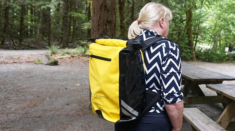 maggie wearing the interior of craft cadence cycling backpack 1