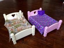 Doll beds showing heart in headboard
