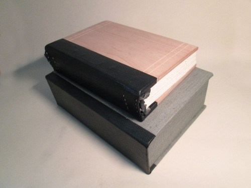 Clamshell box with leather spine