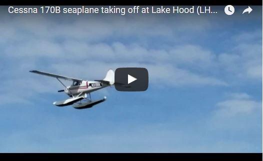 Cessna 170B seaplane taking off at Lake Hood (LHD) Anchorage AK