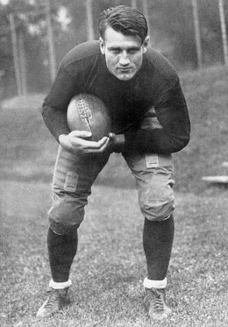 "This is an undated photo of Bronislaw ""Bronko"" Nagurski, University of Minnesota tackle and consensus All-American 1929, in an action pose at an unknown location.  Nagurski  also played in 1930-1937 and 1943 for the Chicago Bears at fullback.  (AP Photo)"