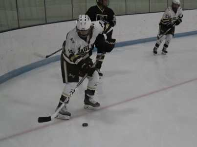 Emma Vogelgesang passing the puck after a defensive play.
