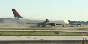Delta forced to make emergency landing as smoke pours from engine