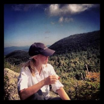 Kim eats an apple atop Mt. Mansfield