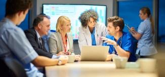 group of doctors having meeting in board room