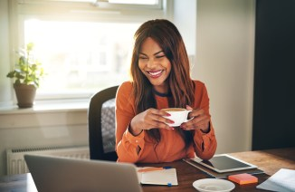 happy woman doing online courses from home office
