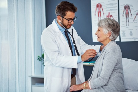 doctor examining woman in doctor's office