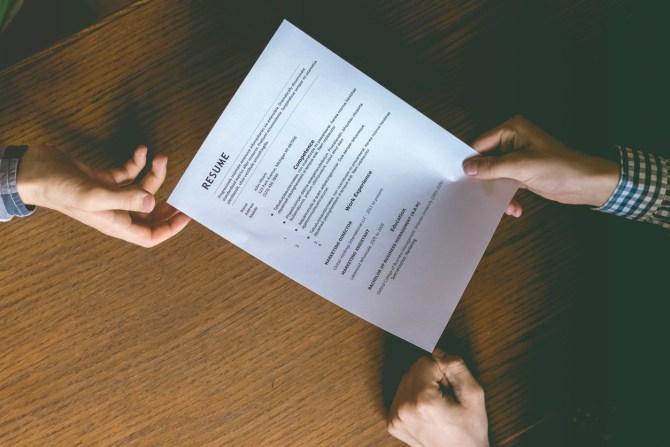 woman holding resume