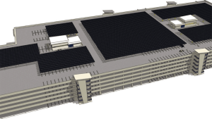 model of large commercial building with rooftop solar panels on top.