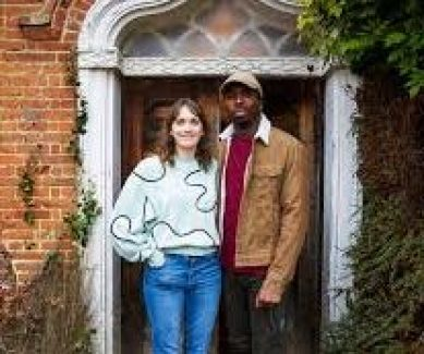 Charlotte Richie and Kyle Smith-Bynoe standing outside Button Hall in BBC Ghosts