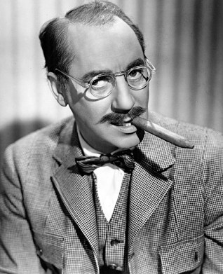 Wise cracking Groucho Marx with his famous cigar prop