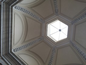 Standing beneath architectural beauty in Rome.