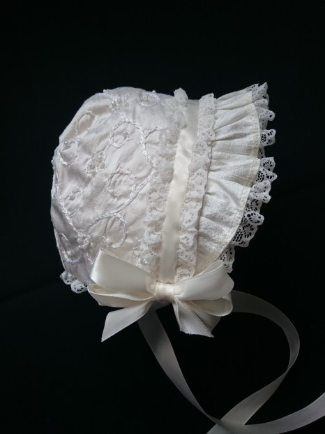 The bonnet, hand stitched over many hours!