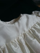 Understitching of the neckline done by hand