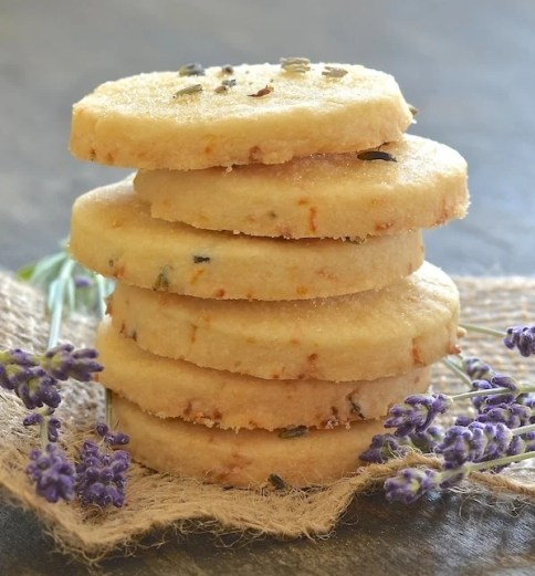 """This beautifully rich Lemon Lavender Shortbread is full of zesty lemon flavour with delicious subtle bursts of floral lavender in every bite. It literally melts in your mouth and has perfect shortbread """"snappability""""!"""