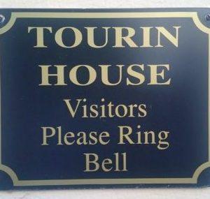 Tourin door sign.