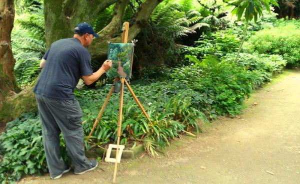 Student working at the Kilmacurragh Painting Workshop along the botanical borders.