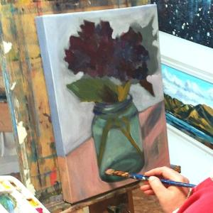 Art student paints flower in a jar with delicate colours. November Painting Course.