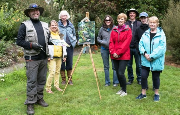Happy painting students with their tutor, Rod Coyne, team photo.