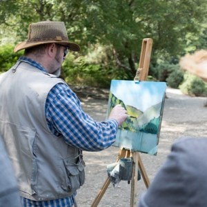 Workshop host, Rod Coyne, completes his painting demo for eager students. There is a magical air on Glendalough's upper lake, a jewel of ire land's ancient east.