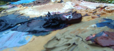 Palette of oil paints mixed and ready for action.
