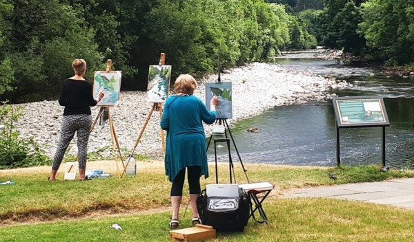 Students capture the river's light and movement with Rod Coyne at Meetings of the Waters.