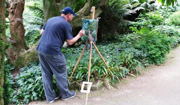 Rod Coyne student lost in his work at Kilmacurragh's Botanical Gardens.