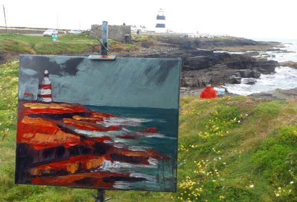 Hookhead Lighthouse in the distance while a very red version of same stands on the easel.