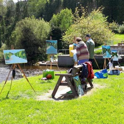 Photo of students working in the sunshine on the banks of the Avoca River during our August Painting Workshop in 2019.