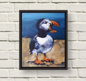 image of preaching puffin painting in a black frame on a white wall