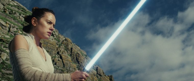 Star Wars: The Last Jedi — Rey holding Luke's lightsaber