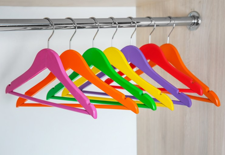 row of colourful coat hangers to inspire your wardrobe edit
