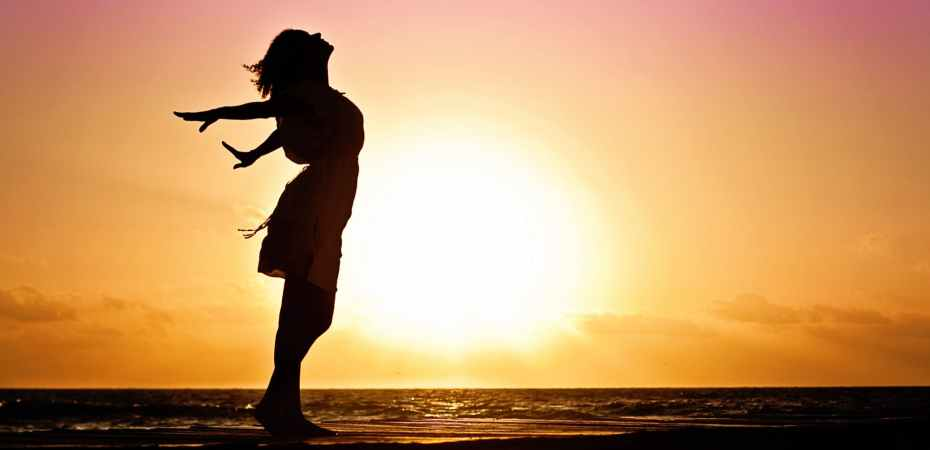 beach woman sunrise silhouette