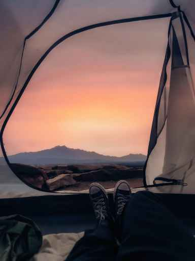 Looking out of your tent as the sun sets behind a mountain is great self care.