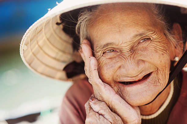 Close up face of beautiful smiling woman with wrinkles. Elderly senior who knows the secret to happiness.