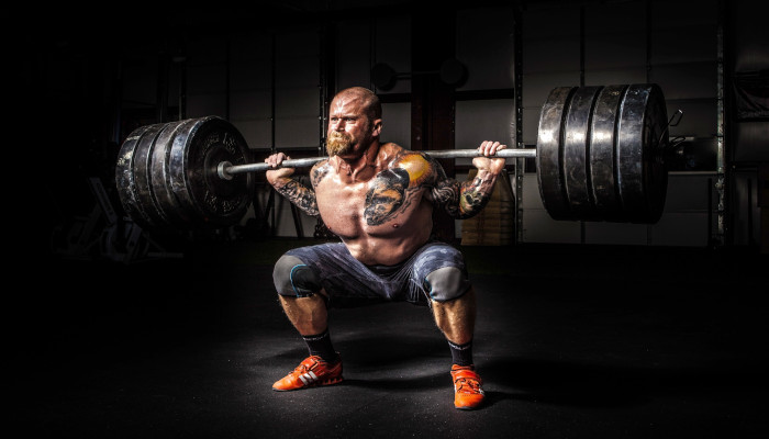Study Shows How to Combine Leg Day & Running Recovering Man