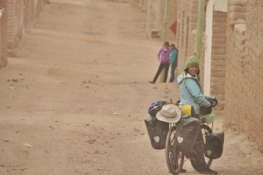 Riding through a small altiplano village.