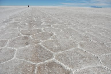 Kevin far off in the distance. The Salar de Uyuni (though not the smaller one I'll talk about next time) has this hexagon shaped natural marks all over the whole thing.