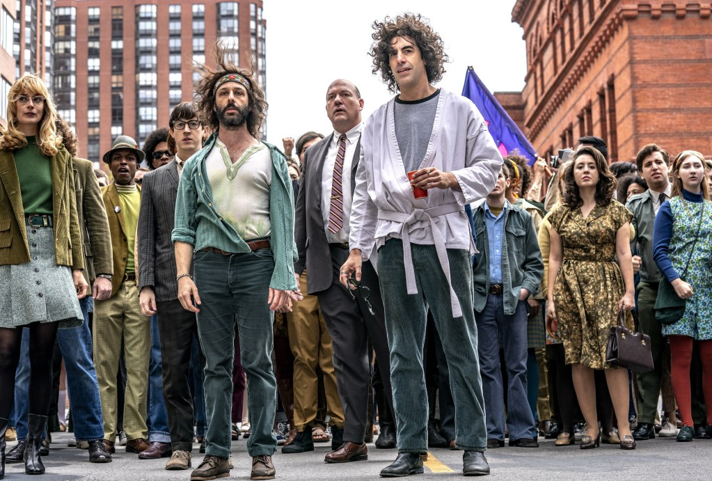THE TRIAL OF THE CHICAGO 7 (L-R) CAITLIN FITZGERALD as DAPHNE O'CONNOR, ALAN METOSKIE as ALLEN GINSBURG, ALEX SHARP as RENNIE DAVIS, JEREMY STRONG as JERRY RUBIN, JOHN CARROLL LYNCH as DAVID DELLINGER, SASHA BARON COHEN as ABBEY HOFFMAN, NOAH ROBBINS as LEE WEINER. NICO TAVERNISE/NETFLIX © 2020.