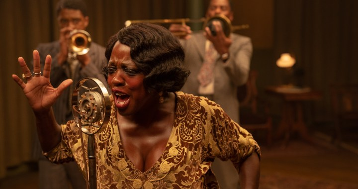 MA RAINEY'S BLACK BOTTOM(2020) Chadwick Boseman as Levee, Viola Davis as Ma Rainey and Colman Domingo as Cutler.   Cr. David Lee/NETFLIX