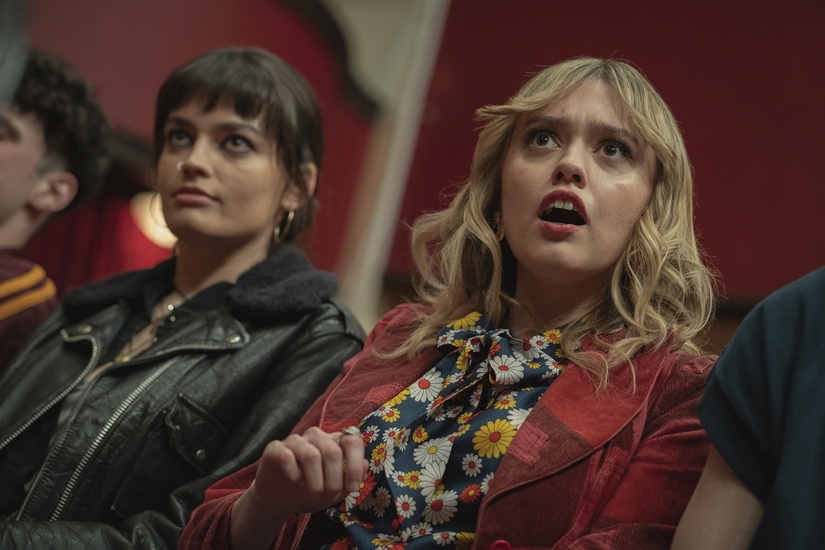 Sex Education Season 3. Emma Mackey as Maeve Wiley, Aimee Lou Wood as Aimee Gibbs in Episode 6 of Sex Education Season 3. Cr. Sam Taylor/NETFLIX © 2020