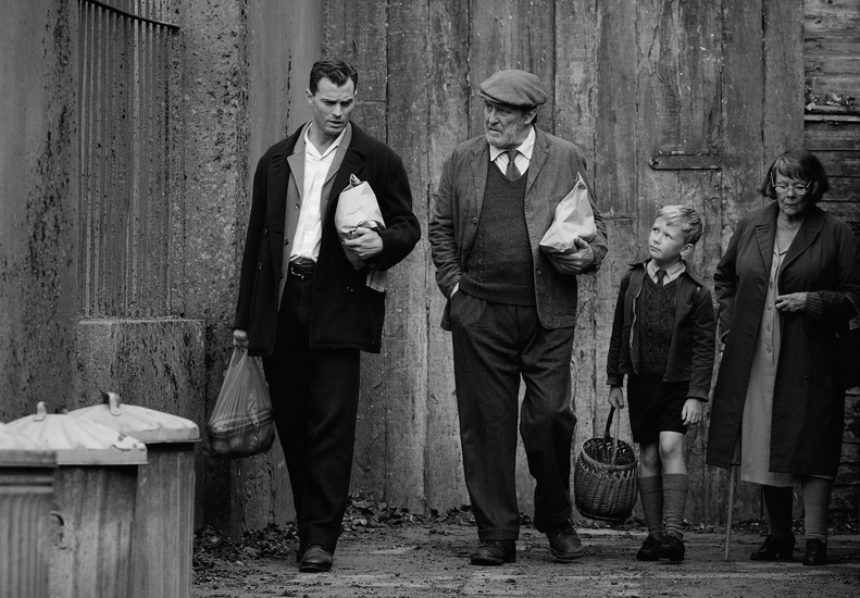 """(L to R) Jamie Dornan as """"Pa"""", Ciarán Hinds as """"Pop"""", Jude Hill as """"Buddy"""", and Judi Dench as """"Granny"""" in director Kenneth Branagh's BELFAST, a Focus Features release. Credit : Rob Youngson / Focus Features"""